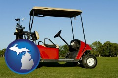 michigan a red golf cart and golf clubs on a golf course