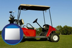 wyoming a red golf cart and golf clubs on a golf course