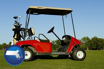 a red golf cart and golf clubs on a golf course - with Massachusetts icon