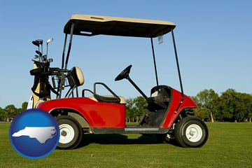 a red golf cart and golf clubs on a golf course - with North Carolina icon
