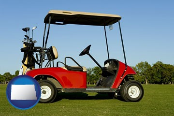 a red golf cart and golf clubs on a golf course - with North Dakota icon