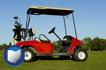 a red golf cart and golf clubs on a golf course - with Ohio icon
