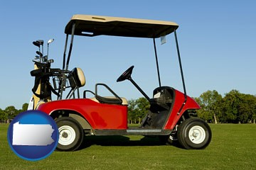 a red golf cart and golf clubs on a golf course - with Pennsylvania icon