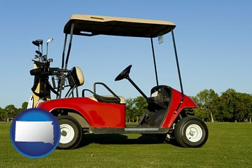 a red golf cart and golf clubs on a golf course - with South Dakota icon